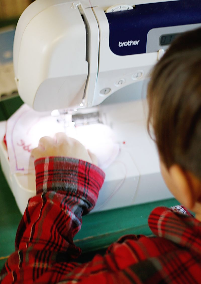 Kid sewing