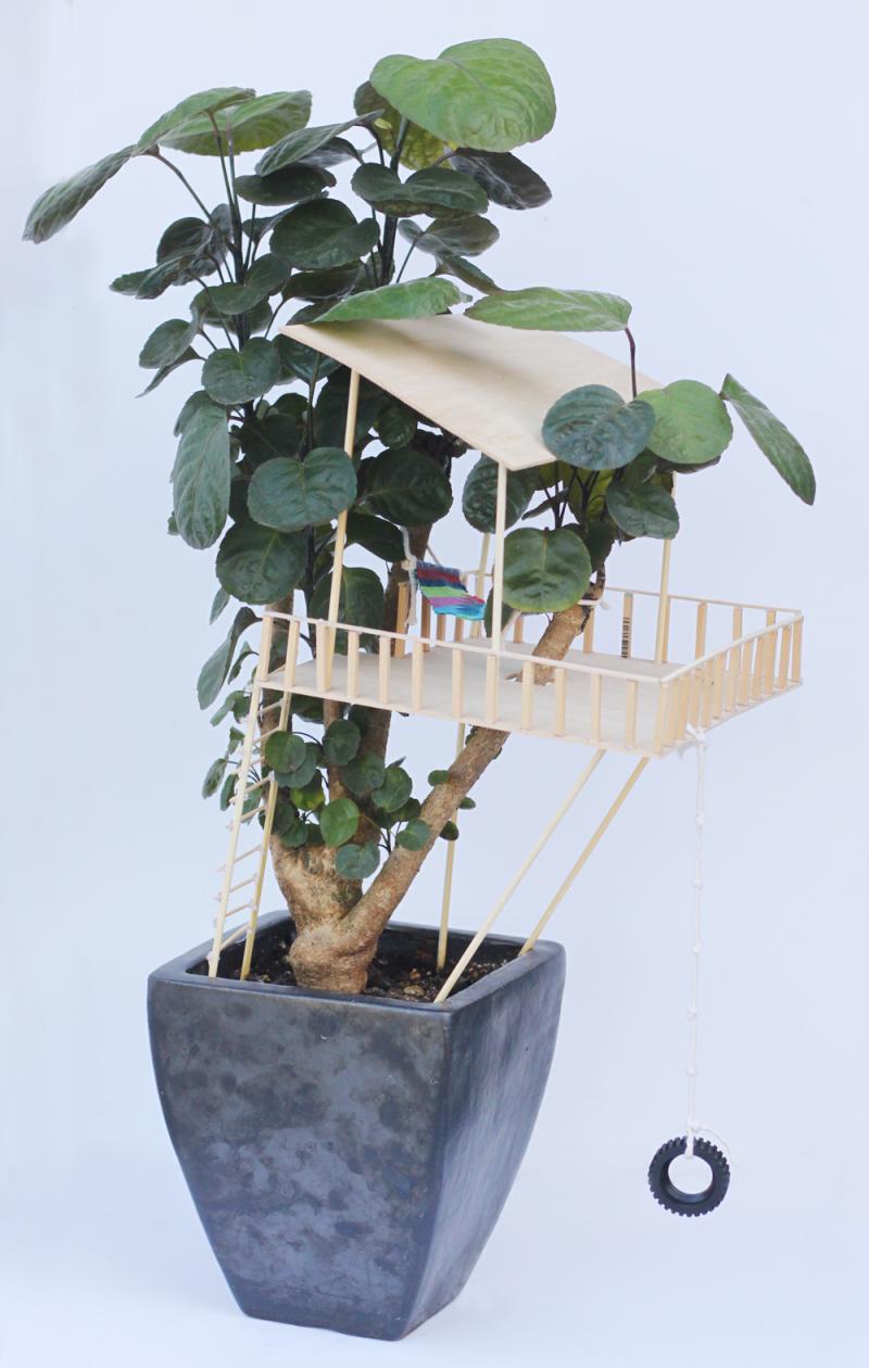 Kid made tiny treehouse