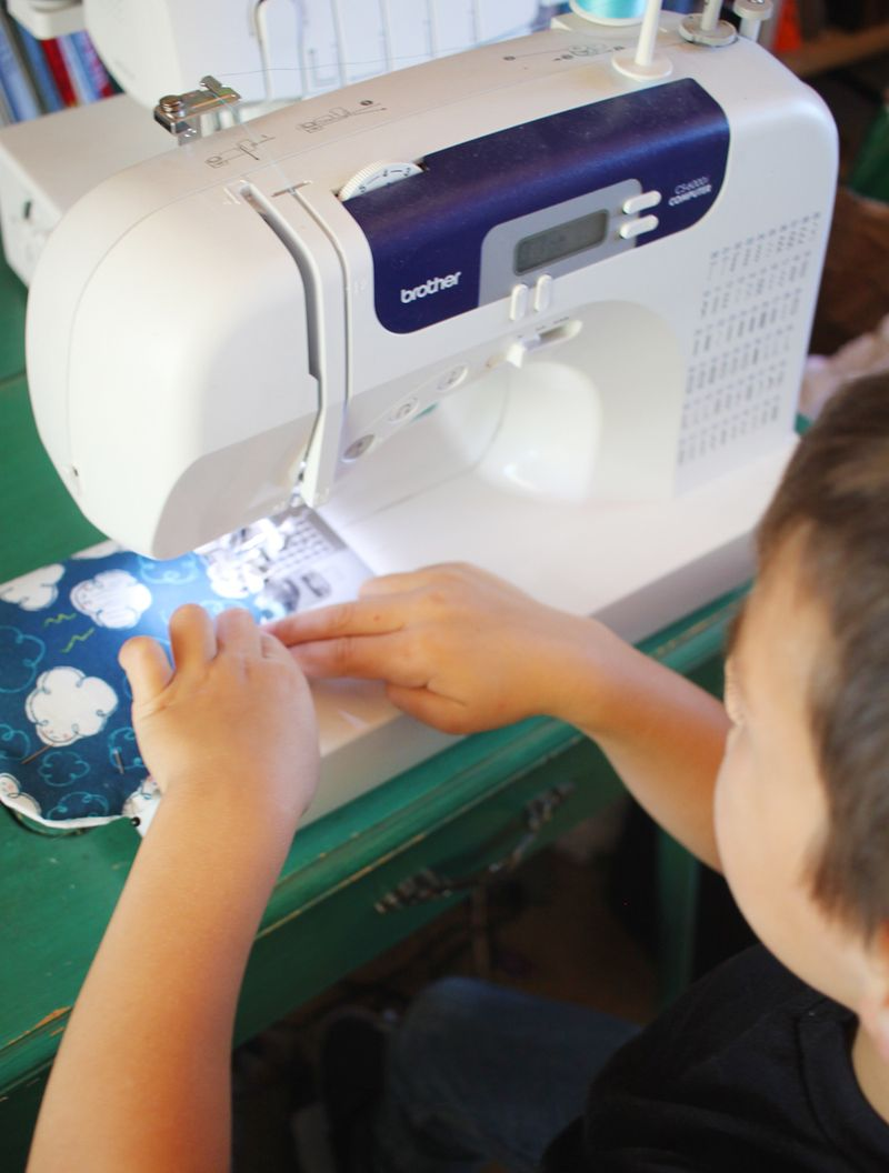 Kid sewing